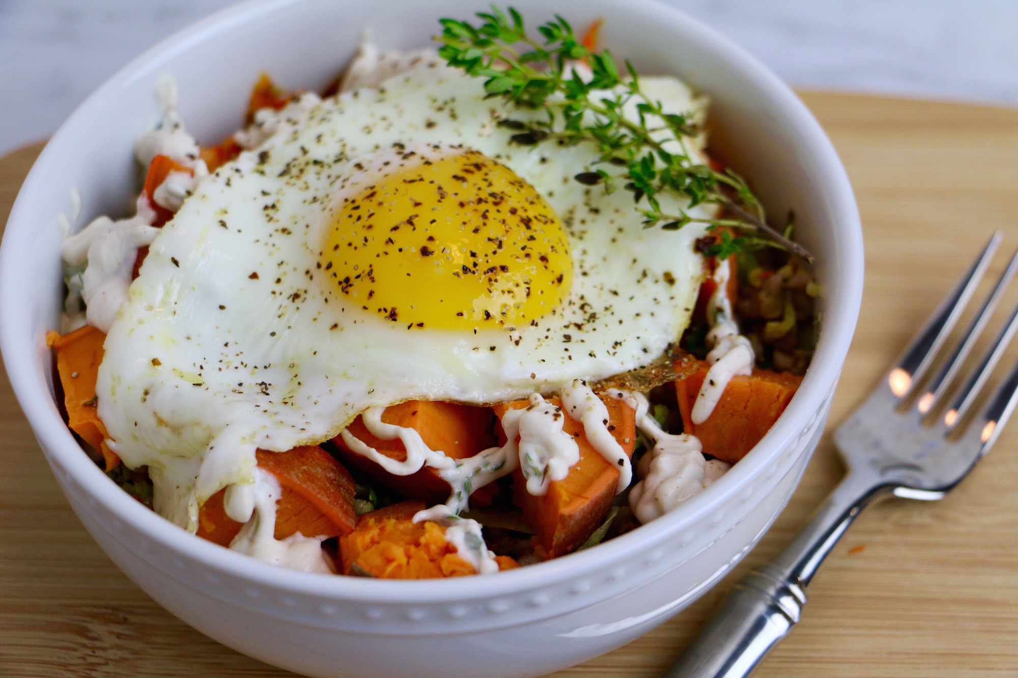 Buckwheat Breakfast Bowl with Savory Roasted Veggies, a Garlic Lemon Tahini Sauce, and a Fried Egg on top! This bowl is healthy, gluten-free, and vegetarian. Make it vegan by removing the egg.