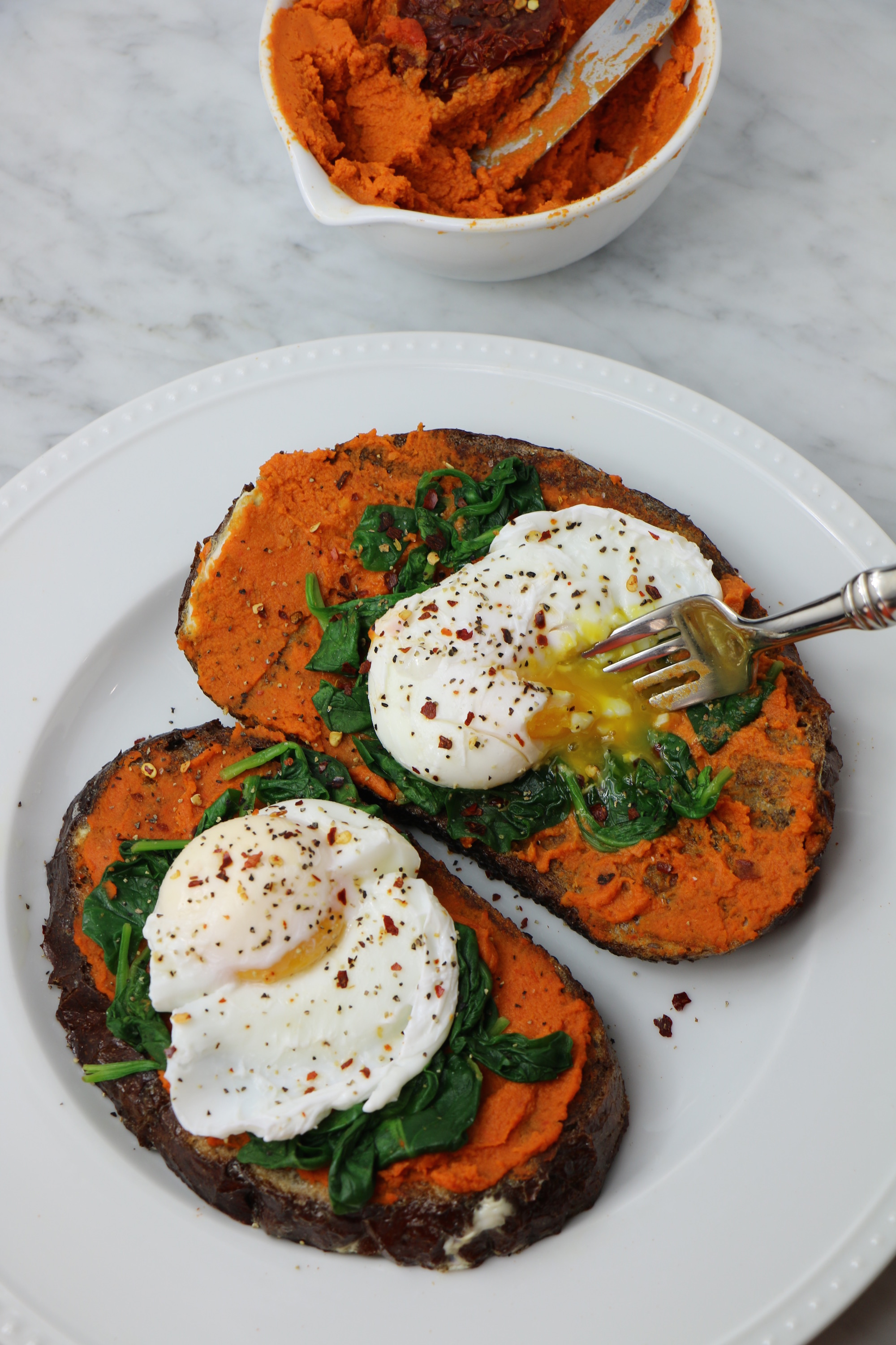 Savory French Toast with Sun-Dried Tomato Hummus, Spinach, and Poached Eggs