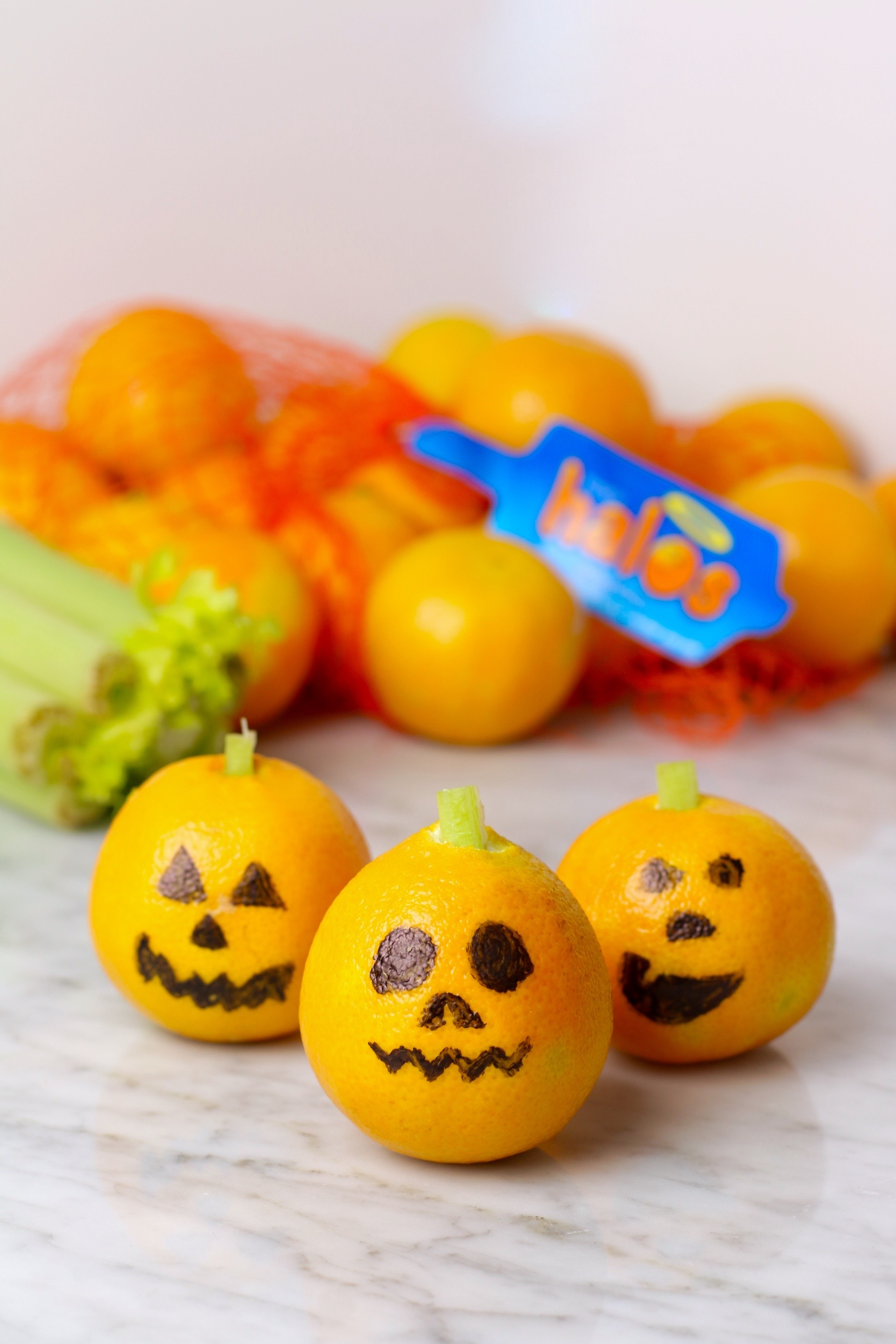 Mandarin Orange Jack O Lanterns - Healthy Halloween Snacks for Kids