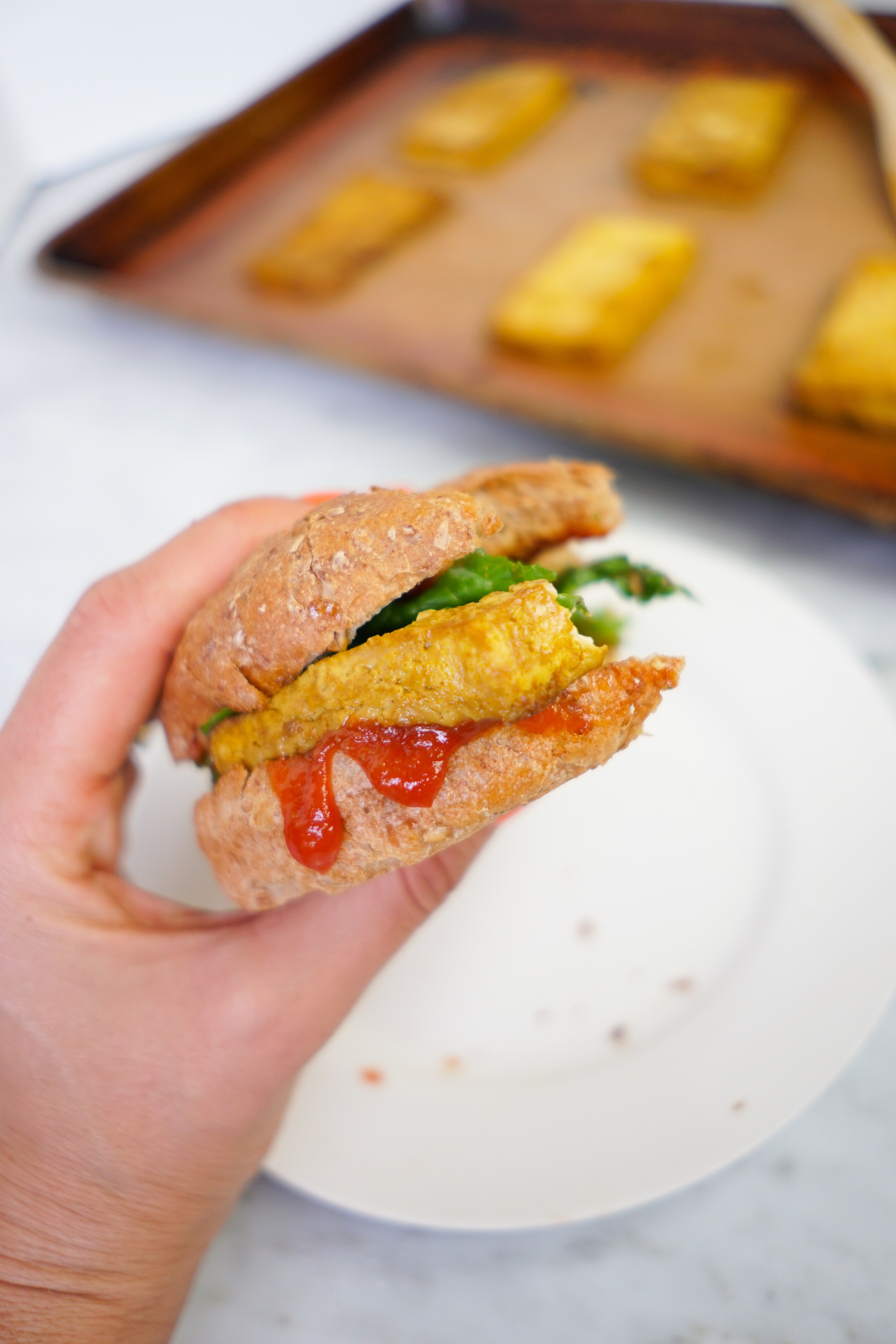 vegan tofu egg sandwich with a bite