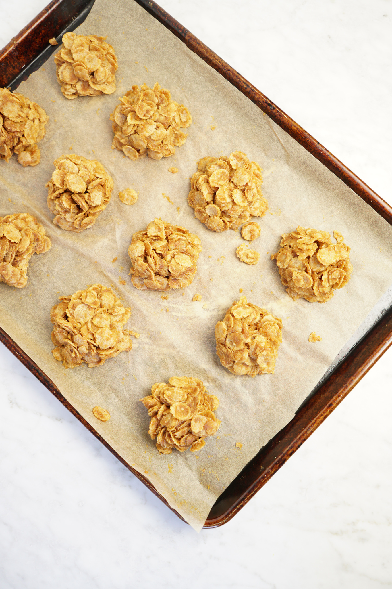 Peanut butter pumpkin cornflake clusters on a pan